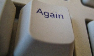 "White computer key, that says ""Again"""
