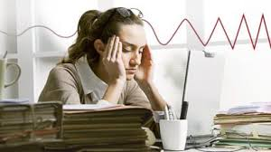 Woman teacher, head in hands, looking very stressed