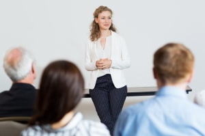 White female teacher lecturing