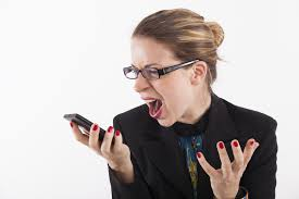 Angry white female holding cell phone