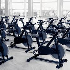 Empty room, full of stationary bikes, to be used for a spinning class