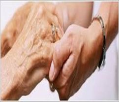 Two older hands, holding each other in caring manner