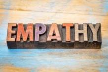 """Block of wood. Carved into it is word, """"Empathy"""""""